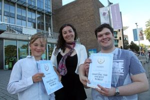 Two pupils being awarded with Classics certificates from Swansea University