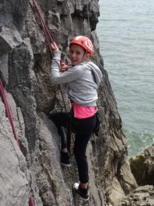 Ffynone House School learning to rock climb with RIPNROCK at Rhossili