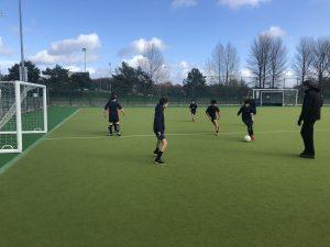 Football Practice on Astro Turf